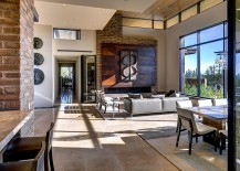 Adobe walls in the living room add texture and native style