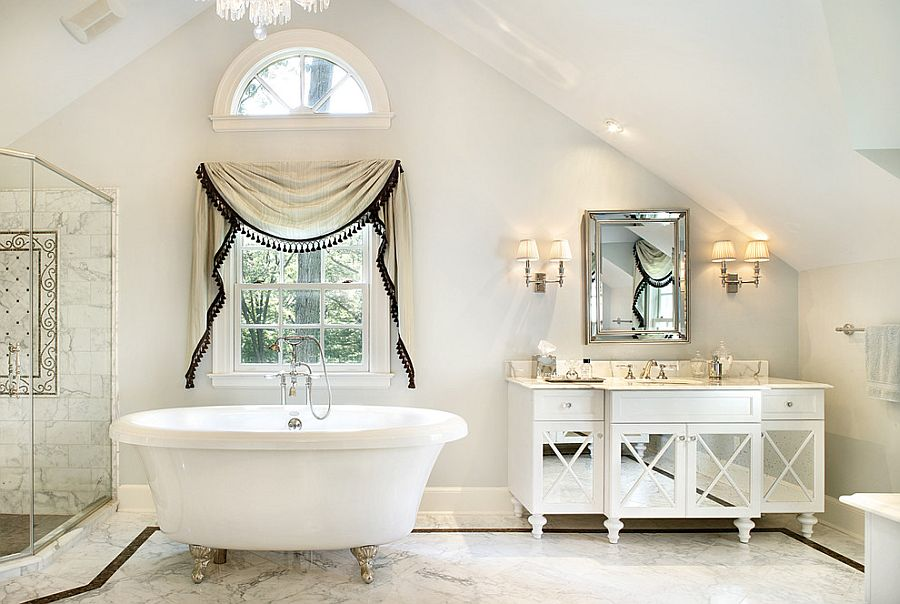 All-white bathroom with a relaxed shabby chic style [Design: Ribbon & Reed Cabinetry]
