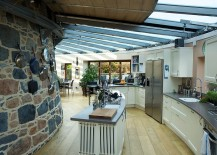 Amazing kitchen with curved wall island and retractable glass roof 217x155 30 Inventive Kitchens with Stone Walls