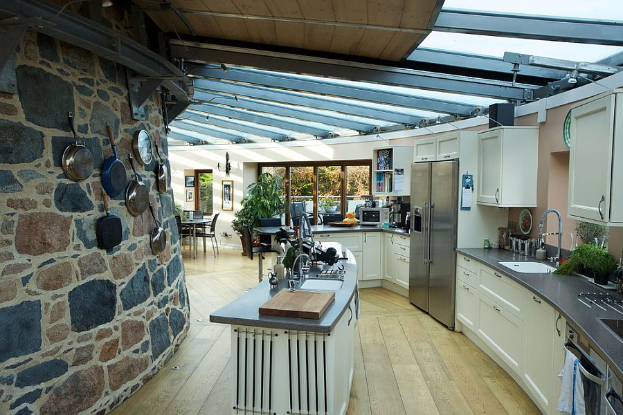 Amazing kitchen with curved wall, island and retractable glass roof
