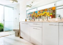 An eclectic collection of colorful tiles also make an appearance in the bathroom