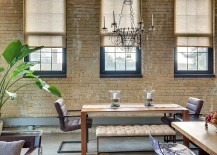 Antique-lighting-fixture-and-unique-windows-steal-the-spotlight-in-the-spacious-dining-room-217x155