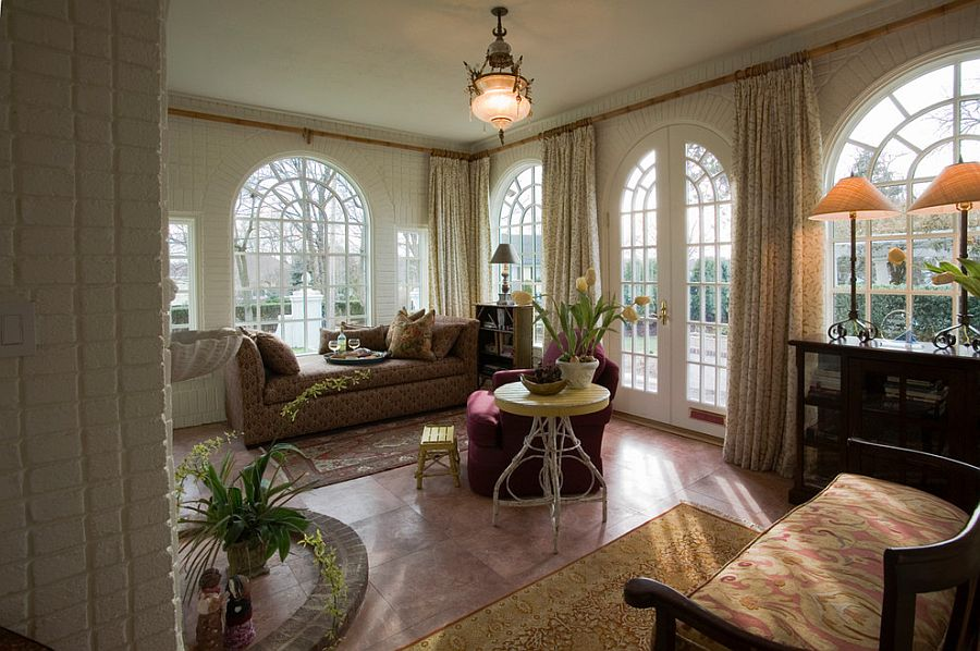 Arched dooorways, heated marble floor and cozy seating for the opulent sunroom