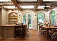 Arched doors, windows and brick walls give the traditional kitchen a Mediterranean vibe