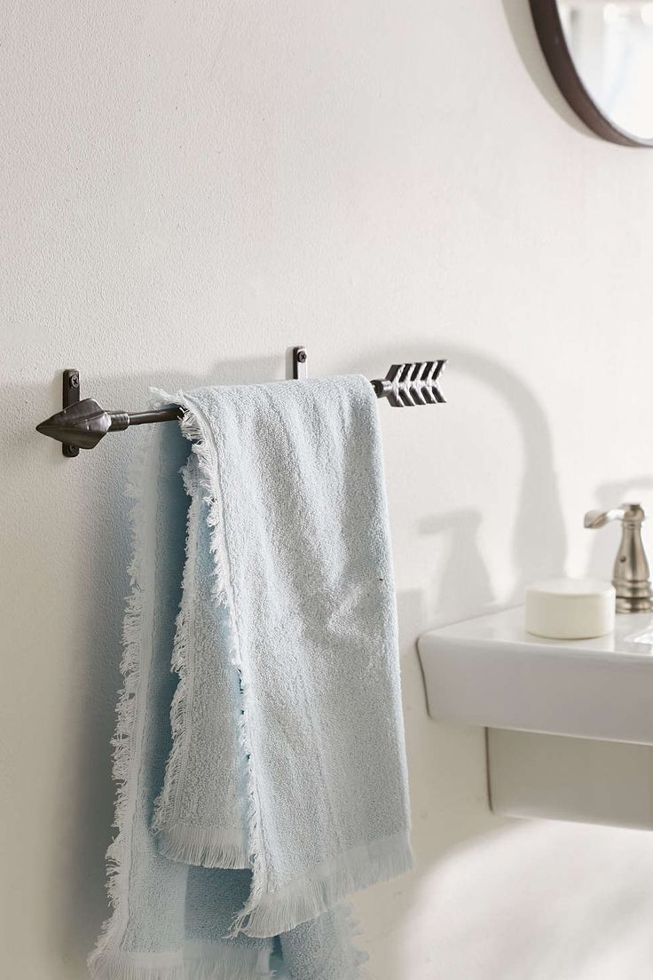 Arrow towel rack in a bathroom