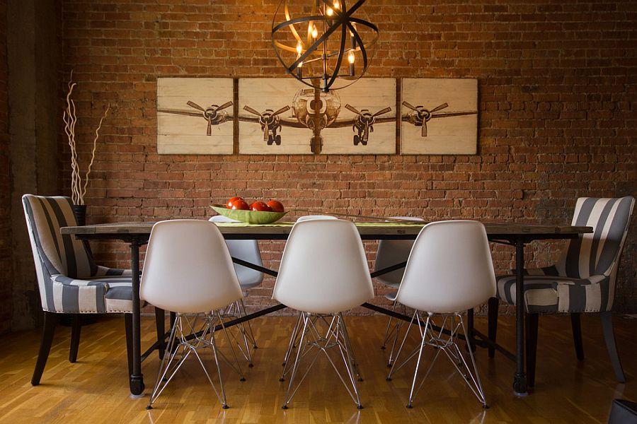 Artwork makes a big impact in the dark, elegant dining room [Design: Design Inside]