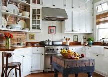 Beach style kitchen with a tiny, custom island