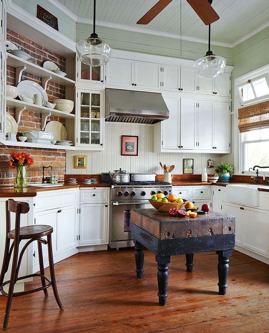 Beach style kitchen with a tiny, custom island [Design: Rosenberg + Gibson Design]