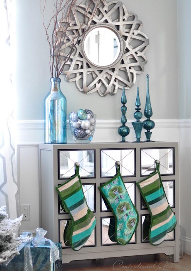 Beautiful blue stockings hung on dresser knobs