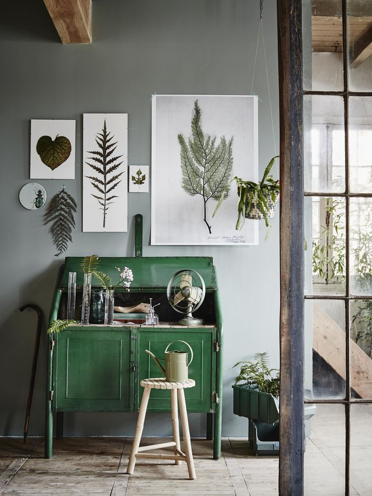 Beautiful nature-inspired wall art above a bright green desk