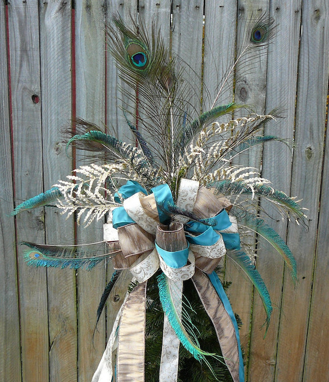 Beautiful peacock feather bow tree topper