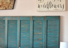 Beautiful turquoise shutters repurposed as a headboard