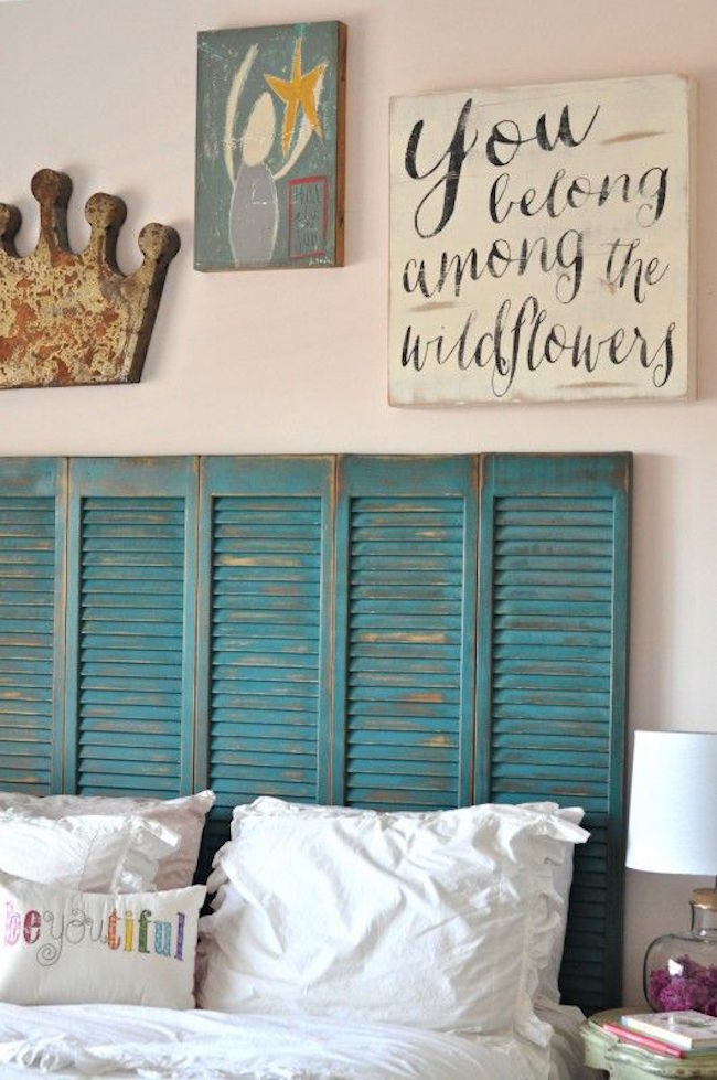 Beautiful turquoise shutters repurposed as a headboard