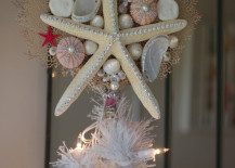 Beautiful white starfish tree topper with sea urchin and seashells