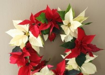 Beautiful wreath made out of red and white poinsettias 217x155 17 Lovely Ways to Display Poinsettias for the Holidays