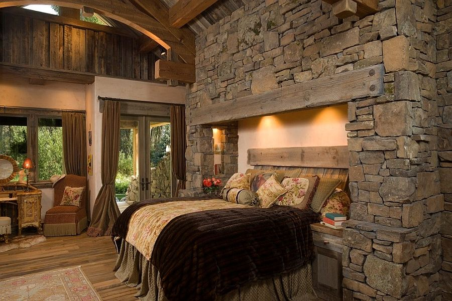 Bed recessed into the stone wall with fuzzy lighting [Design: Hoyt / CTA Architects]