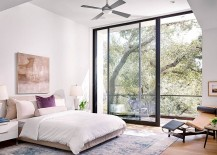 Bedroom-with-a-small-balcony-and-plush-decor-217x155