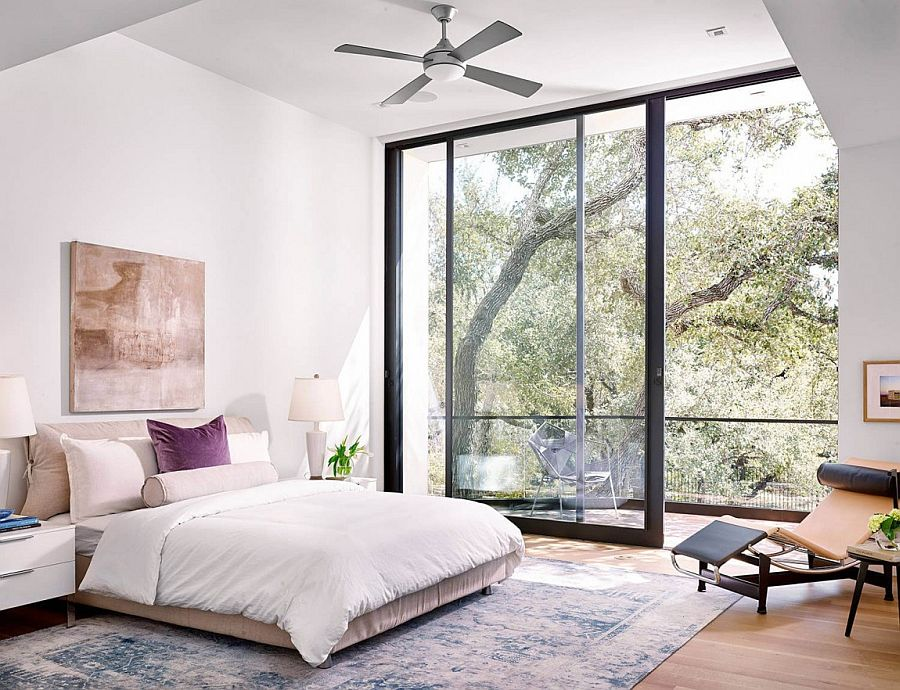 Bedroom with a small balcony and plush decor