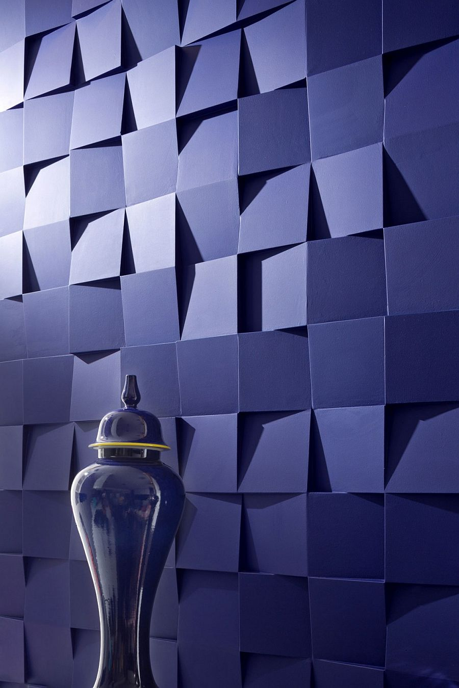 Bespoke 3D wall panels designed by Sergey Makhno steal the show inside this small Kiev apartment