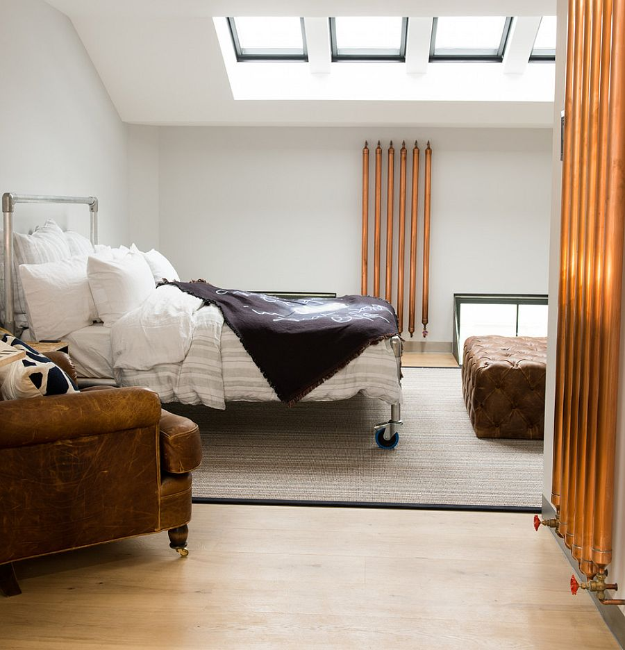 Bespoke bed steals the spotlight in this bedroom with skylights