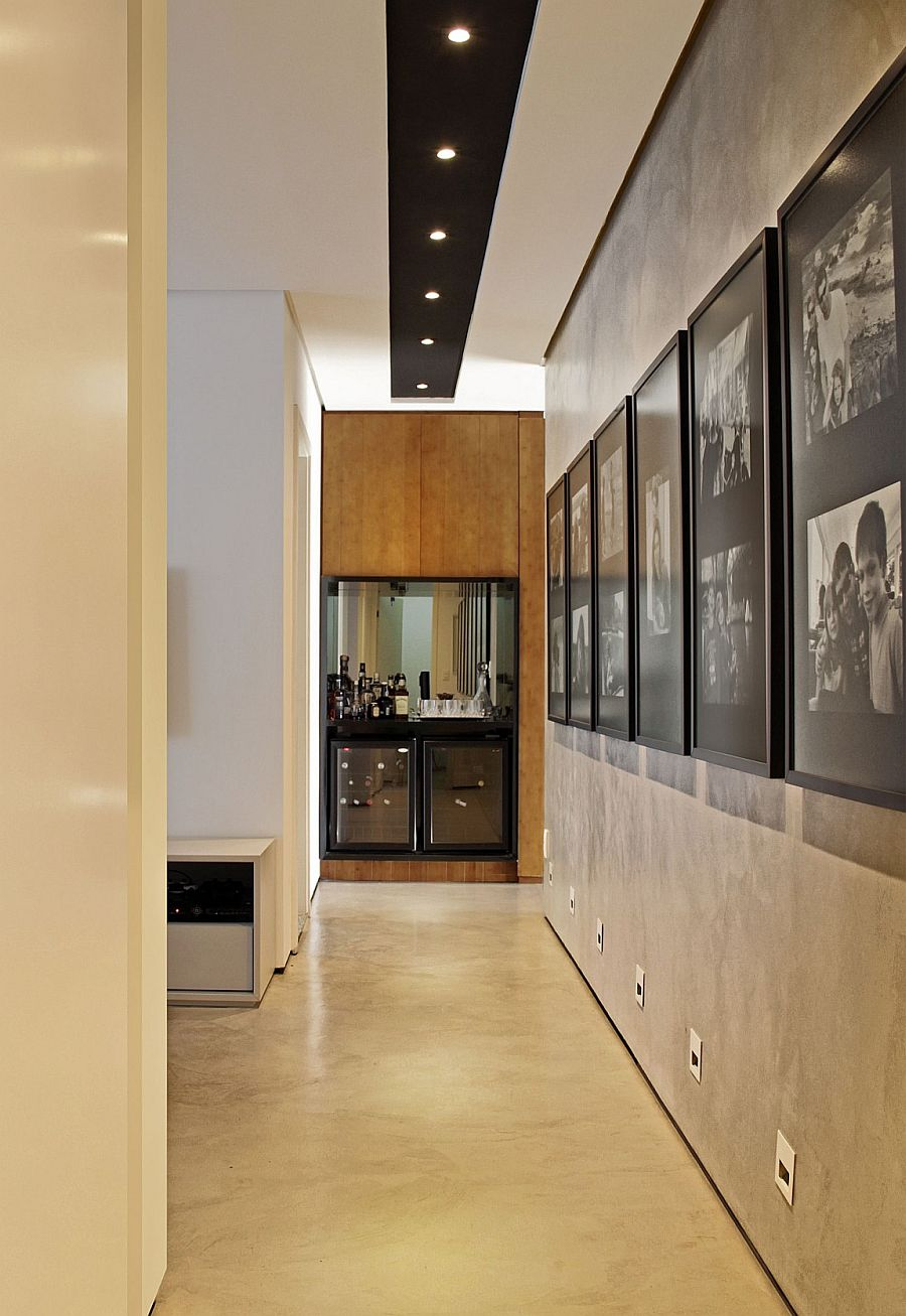 Black and white framed photographs fit in perfectly with the ambiance of the room