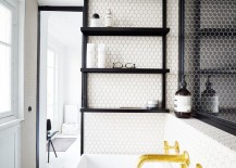 Black shelves installed on wall beside bathtub in Parisian apartment 217x155 15 Exquisite Bathrooms That Make Use of Open Storage