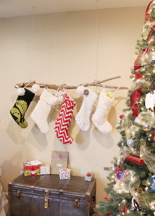 Branch hung from the ceiling to hold stockings