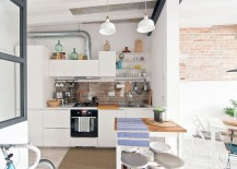 Brick backsplash in the kitchen links it visually with space next to it [Design: TheHallStudio]
