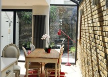 Brick wall extension with a glass roof is a popular choice for a small and cheerful dining space