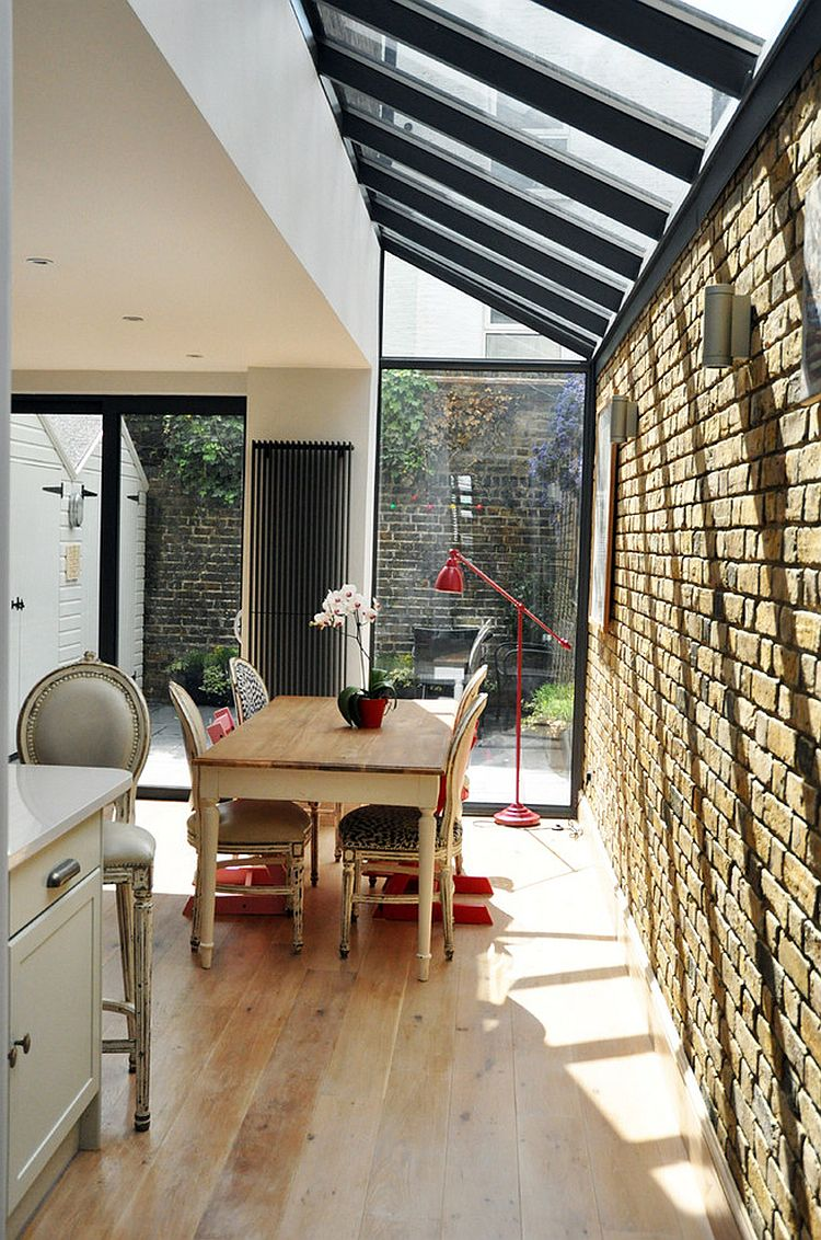 Brick wall extension with a glass roof is a popular choice for a small and cheerful dining space [Design: Emilie Mauran Renovation]