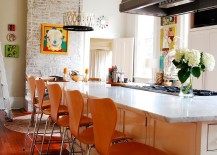 Brick wall fireplace becomes a focal point in the colorful, eclectic kitchen [Photography: Corynne Pless]