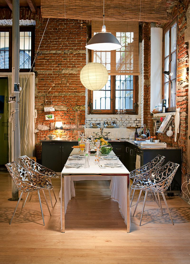 Brick wall in the kitchen becomes a part of the dining room visual [Design: Driade]