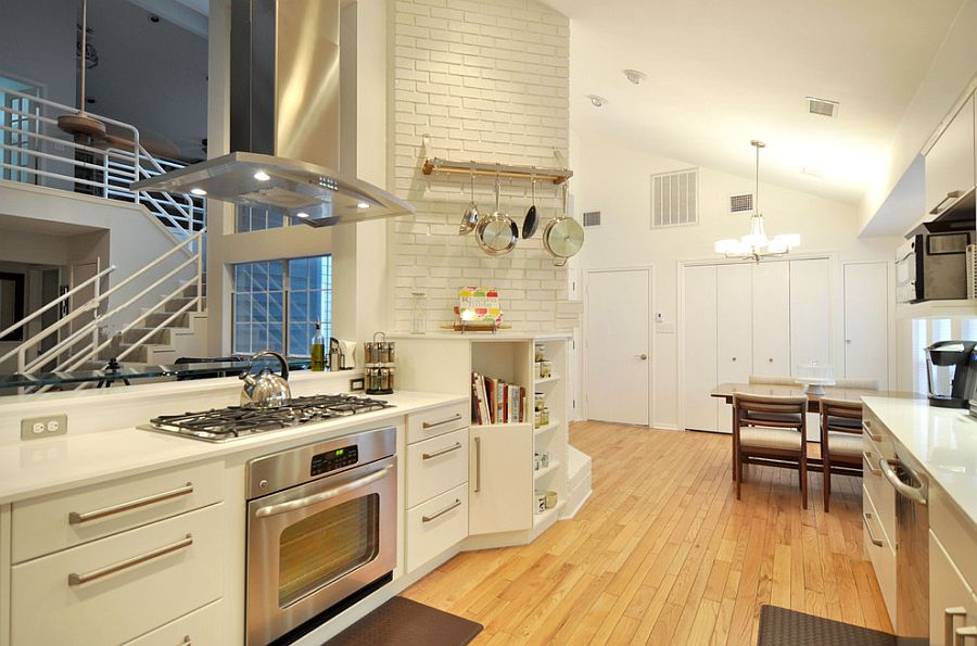 Brick wall section of the kitchen plays in beautifully with the modern vibe of the kitchen [From: The Kitchen Source]
