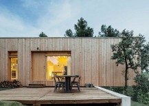 Cantilevered-portion-of-the-wooden-home-adds-to-the-dramatic-appeal-of-the-exterior-217x155