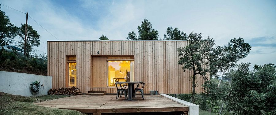 Cantilevered portion of the wooden home adds to the dramatic appeal of the exterior