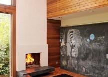 Chalkboard-sliding-door-conceals-the-media-unit-217x155