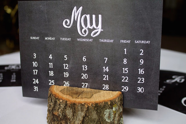 Chalkboard-style calendar printout with tree trunk holder