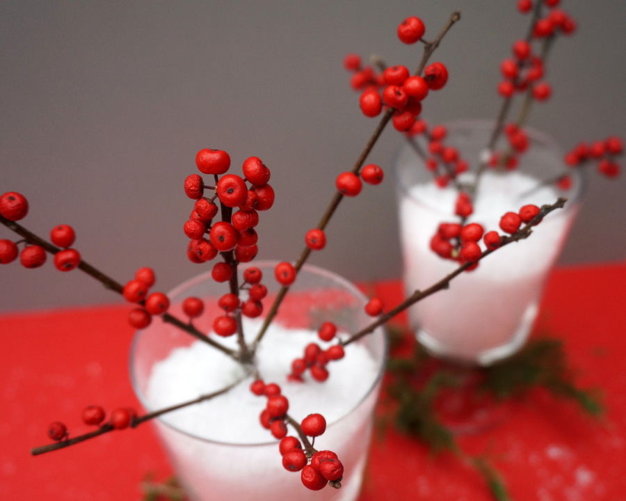 Christmas centerpiece with red berries and snow