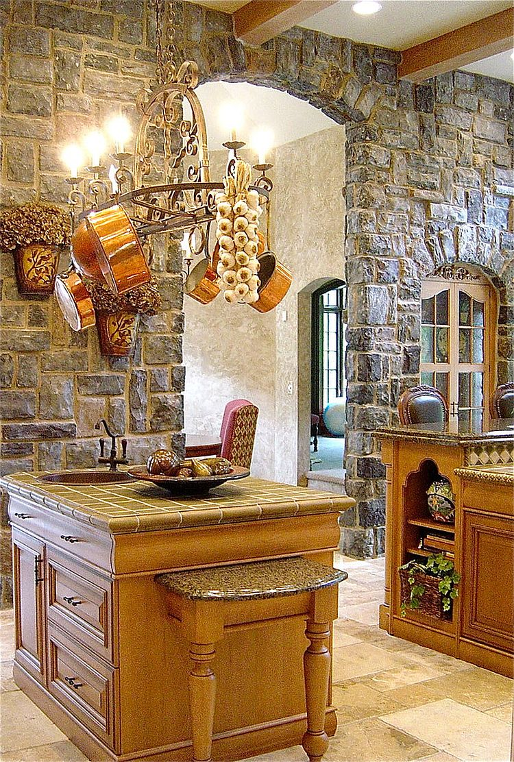 Classic European style kitchen with unique stone walls and limestone flooring [Design: Minion Gutierrez]