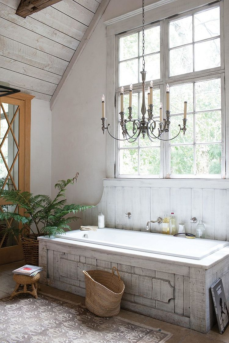 Classic chandelier, unique bathtub and farmhouse charm shape a relaxing bathroom