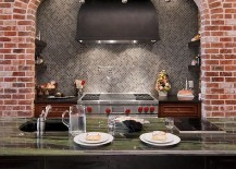 Classic kitchen combines brick walls with refined granite countertops [Design: In Detail Interiors]