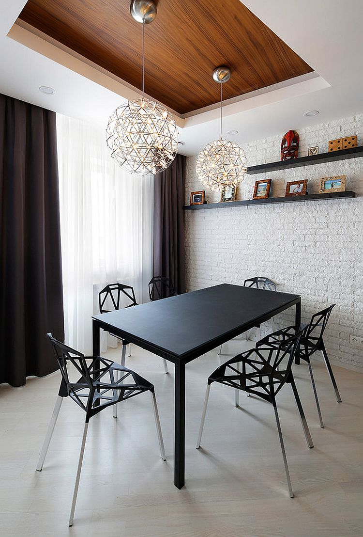 Classy contemporary decor stands out in this small dining space [Design: Olga Klevakina]