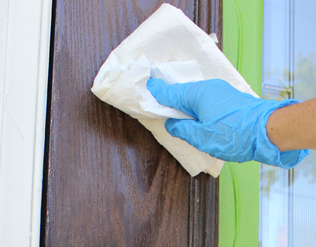 Cleaning the front door (photo credit: Bright Bold and Beautiful)