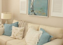 Coastal themed living room with shutters on either side of artwork 217x155 7 Inspiring Ways to Use Vintage Shutters on Your Walls