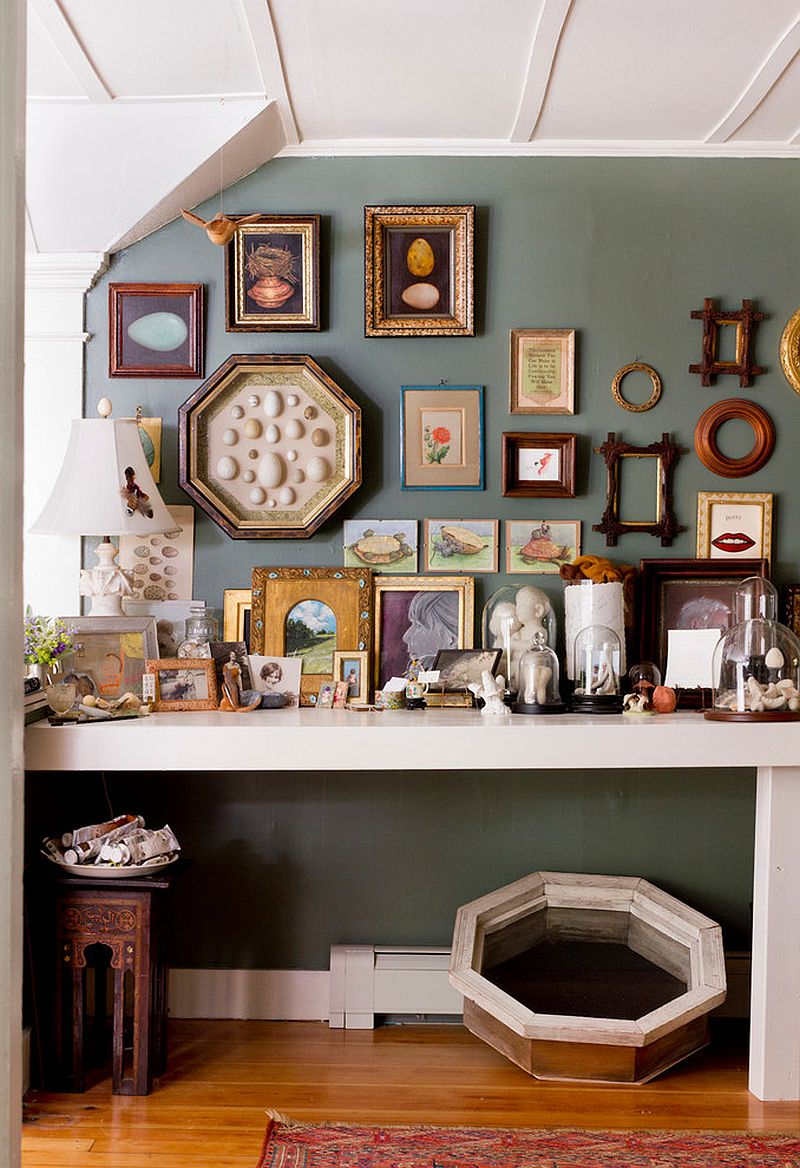 Collection of picture frames makes a big impact in this small home office [From: Rikki Snyder]