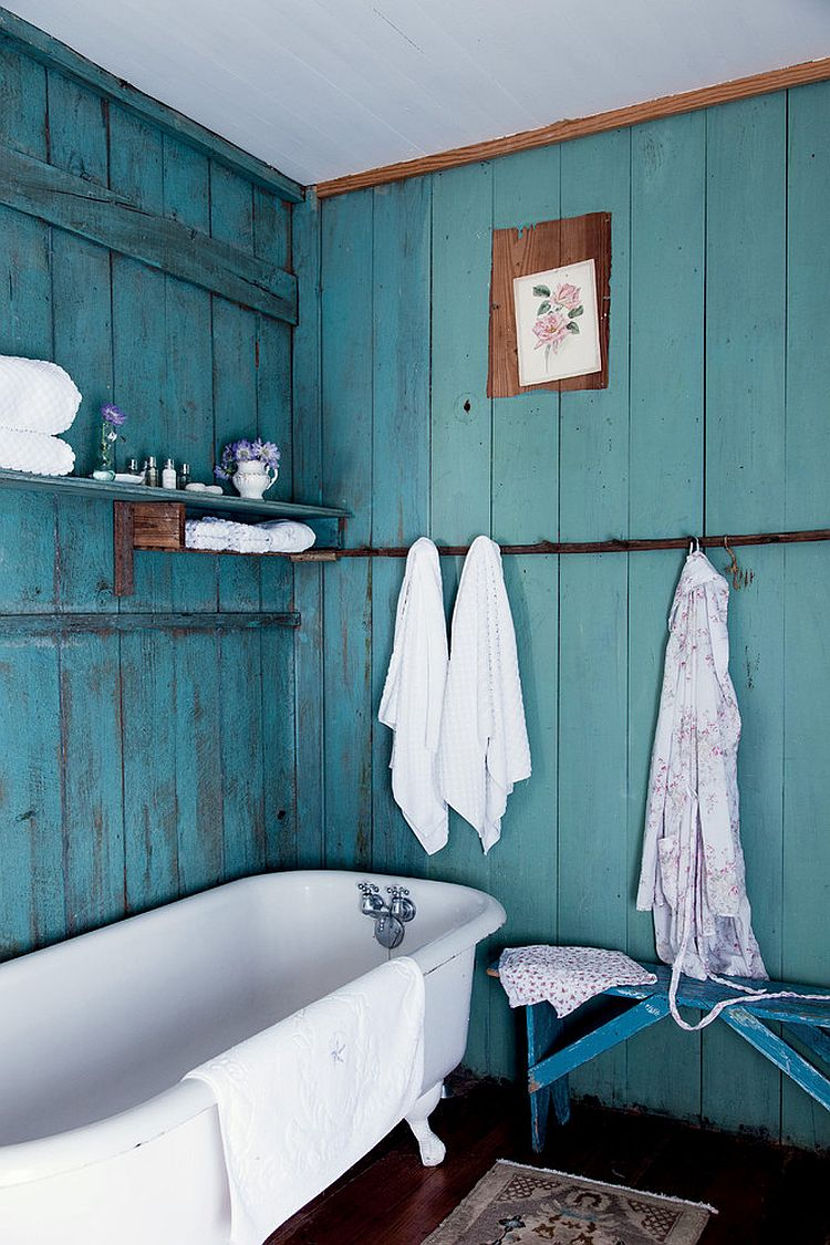Color of the backdrop turns the small bathroom into a more spacious setting visually [Photography by Amy Neunsinger]