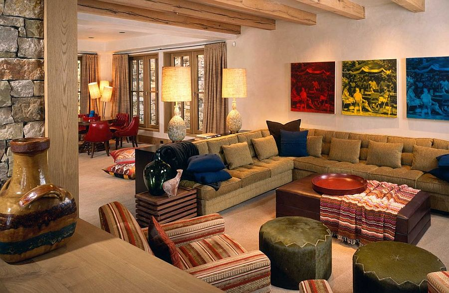 Colorful prints in the backdrop enliven the rustic family room