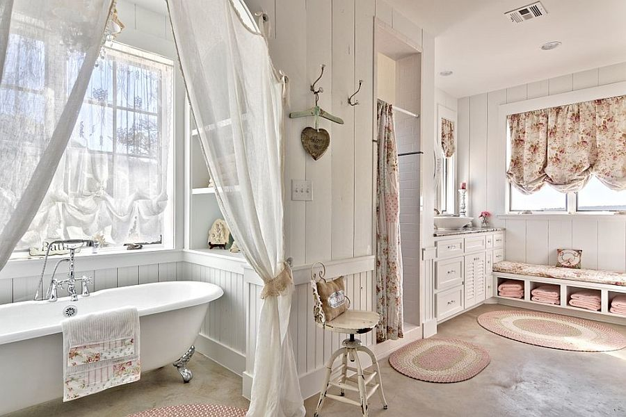 Comfy shabby chic bathroom in white with claw-foot bathtub [Design: Schmidt Custom Homes]