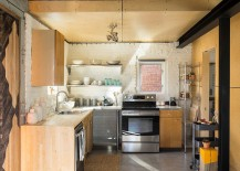 Compact kitchen design with ample shelving and storage space [Design: Design Platform]