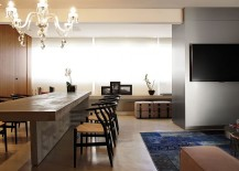 Concrete-slab-couple-with-wishbone-chairs-makes-for-a-stunning-dining-space-217x155